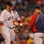 Red Sox starter Jon Lester is pulled by manager John Farrell after the first two batters reached in the sixth.
