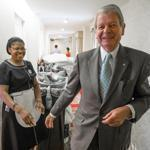 Room attendant Marie Latouche shares a laugh with Denis.