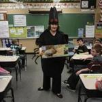 Deirdre Arvidson, a public health nurse with the Barnstable County Department of Health and Environment, talked with third-graders at the Forestdale School in Sandwich while dressed in a giant tick costume.