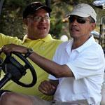 President Obama played the links with his longtime Chicago friend, Eric Whitaker, at Mink Meadows Golf Club.