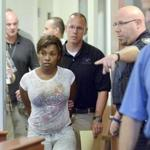 Audrea Gause of Troy, N.Y., was led into court to be arraigned on charges of defrauding the One Fund Boston of $480,000.