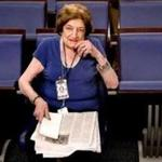 Long-time White House correspondent Helen Thomas in the front row of the Press Briefing Room in the West Wing of the White House.