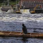 Joseph Dana paddles a traditional handmade birch canoe on the Penobscot River and watched as the Veazie Dam was breached in Eddington, Maine.