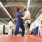 Instructor Valentina M. Perez demonstrated a judo move with Thomas White at Ultimate Self Defense & Performance, which is one of the gyms in South Boston that will offer free self-defense and martial arts classes to train women.