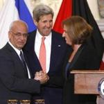 From left: Chief Palestinian negotiator Saeb Erekat , Secretary of State John Kerry, and Israel's Justice Minister Tzipi Livni  at a news conference.