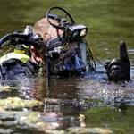 A Connecticut State Police Dive Team continued to search Pine Lake in Bristol, Conn. or the second day.