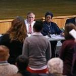 As a member of Martin Walsh's transition team, George Perry Jr. (seated in white shirt) attended a town hall meeting on education at Boston English High School in December.