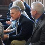 "Brothers Shawn (right) and Mark O'Hagan (center) sat in court in St. Johnsbury, Vt., before the arraignment of Richard Fletcher and Keith Baird Monday. Shawn called it ""the final chapter of this process."""