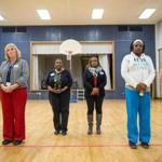 During a group exercise at the Franklin D. Roosevelt School in Hyde Park, teachers and parents were asked to take a step forward or backward depending on how they answered questions.