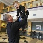 Jesse Reynolds, with his son, Cole, 3, at Southern New Hampshire University, where he earned a bachelor's in justice studies Saturday.