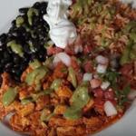 Plato Mexicano with marinated chicken (left) and torta al pastor (bottom right) at La Victoria Taqueria.