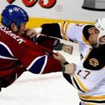 Montreal, QC, CANADA - 04/22/09 - Boston Bruins left wing Milan Lucic #17 connects with a right to the face of Montreal Canadiens defenseman Mike Komisarek #8 during a fight late in the 2nd period. - (Globe Staff Photo / Barry Chin) section: Sports, reporter: Fluto Shinzawa, slug: 23bruins. Library Tag 04232009 Sports