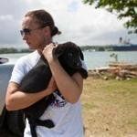 Sato Project founder Christina Beckles comforts a dog that needs rescuing on the Dead Dog Beach in Puerto Rico in March.