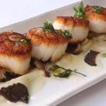 Scallops with truffled celery root puree at Les Zygomates.