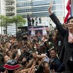Prime Minister Yingluck Shinawatra greeted supporters in Bangkok on Wednesday. Thailand's high court ordered her to step down immediately, along with Cabinet members.