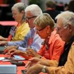 At the AARP convention in Boston this week, advisers helped participants navigate on tablets.