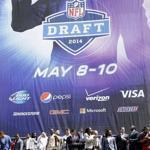 Draft prospects appeared atop the marquee at Radio City Music Hall, sit of the draft, on Wednesday.