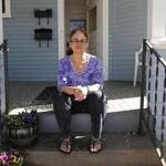 PorchFest founder Nancy Goodman on her front porch in Somerville.