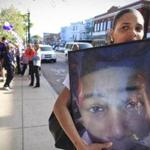 Towanda Kellam carried a framed picture of her 15-year-old son, Lance Hartgrove, who was murdered on July 10, 2012.