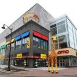 A 20-foot tall giraffe in front of the new Legoland Discovery Center in Somerville's Assembly Row.