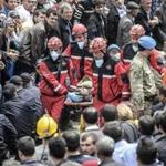 Rescuers carried out the body of a miner Wednesday. The official death toll from the disaster rose to 274.