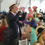 Joshua Janson, of Boston, attended the annual Party in the Park Luncheon that benefits the Emerald Necklace Conservancy was held on the Pinebank Promontory on Wednesday.