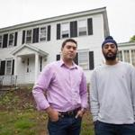 Carlos Bello and Jasjaap Sidhu in front of Delta Kappa Epsilon, near the college campus. About 100 students participate in Greek life at Amherst.