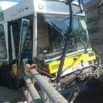 The bus dangled from a bridge in Newton Corner.