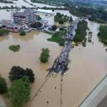 Rising waters inundated buildings and roads Sunday in the Serbian town of Obrenovac, 18 miles southwest of Belgrade.