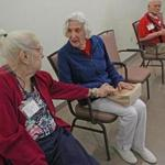 Evelyn Domba (left) and Devora Corman before an exercise class at the Adult Day Health Program at Hebrew Rehabilitation Center in Roslindale.