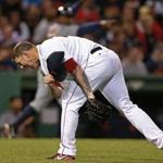Jake Peavy takes off his hat and howls after Torii Hunter's fifth-inning hit-and-run single.