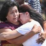 A woman hugged her daughter as they recalled a family member who was killed during the 2013 tornado.