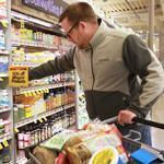 David Harris shops for the family at Whole Foods in Arlington.