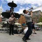 Matt Finstein, 28, of Lower Allston played trombone on the Boston Common with bandmates (from left) John Baylies, 22, of Allston, Matt Salvo, 23, of Waltham, and Gabriel Labovitz, 23, of Watertown.