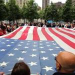 Firefighters, police, members of the military and the public participate in the ceremonial transfer of the National 9/11 Flag into the The National September 11 Memorial Museum.