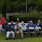 A group of people gathered to watch the Memorial Day Ceremony at Mount Hope Cemetery in Mattapan.
