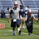 Tom Brady and the Patriots are taking the first steps toward the 2014 campaign with this week's practices. Jonathan Wiggs, Globe Staff