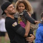 Tom Brady cradled his niece before the Best Buddies Challenge: Hyannis Port Event.