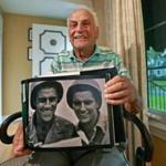 Arthur Cotton, 89, of Framingham, who landed on Utah Beach, held a photo taken during the war of him and his late brother Thomas.
