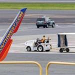 Damage to the left wing of a Southwest aircraft would be seen at Logan on Monday.