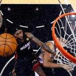LeBron James scored a game-high 35 points in the Heat's 98-96 victory over the Spurs.