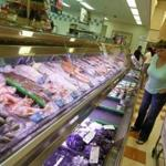 A customer looked at the seafood on display at the Market Basket in Burlington.