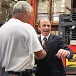 Arthur T. Demoulas (center) thanked workers in the warehouse at Market Basket's headquarters in Tewksbury on Thursday.