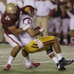 Southern California quarterback Cody Kessler (6) is sacked by Boston College linebacker Matt Milano (28) during the second half of their NCAA college football game Saturday, Sept. 13, 2014 in Boston. (AP Photo/Stephan Savoia)