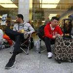 Shoppers waiting for the new iPhone lined up outside the Apple Store on Boylston Street in Boston Thursday