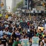 People marched during a rally against climate change in New York.