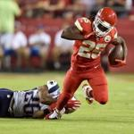 KANSAS CITY, MO - SEPTEMBER 29: Jamaal Charles #25 of the Kansas City Chiefs is tripped up by Logan Ryan #26 of the New England Patriots during the first quarter at Arrowhead Stadium on September 29, 2014 in Kansas City, Missouri. (Photo by Peter Aiken/Getty Images)