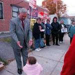 Menino reached out to his grandchild Taylor Menino outside his Hyde Park polling place in 2001.