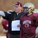 Whittier Regional coach Kevin Bradley points out pass routes to his son and senior quarterback,