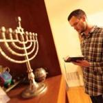 Patrick Bodien taking part in Maariv, a Jewish prayer service held in the evening, at his Swampscott home.